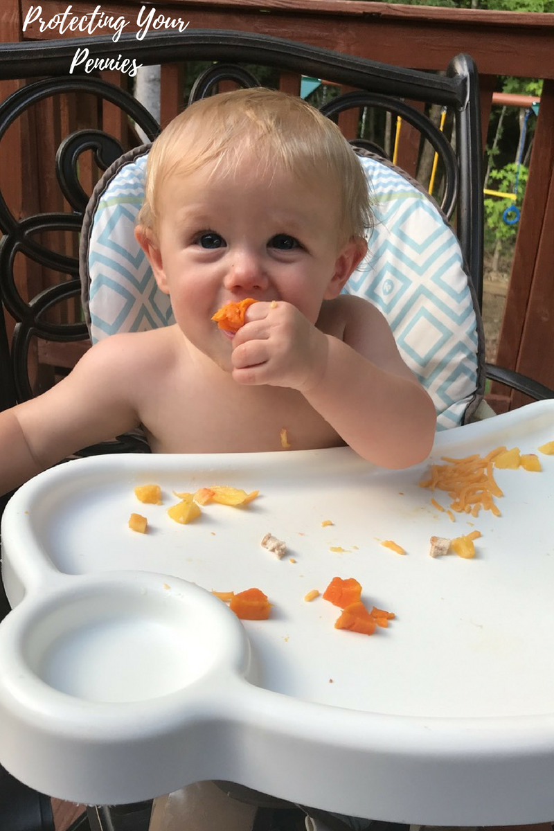 Baby eating in highchair Stimulate Your Baby